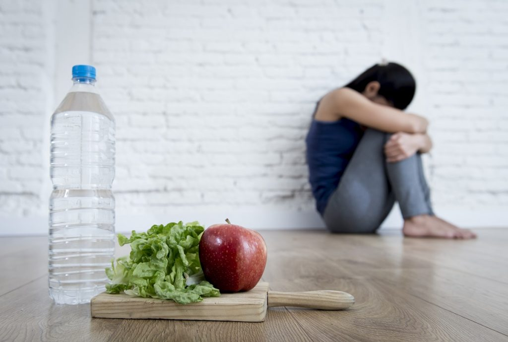 Girl with eating disorder can't having problems with eating